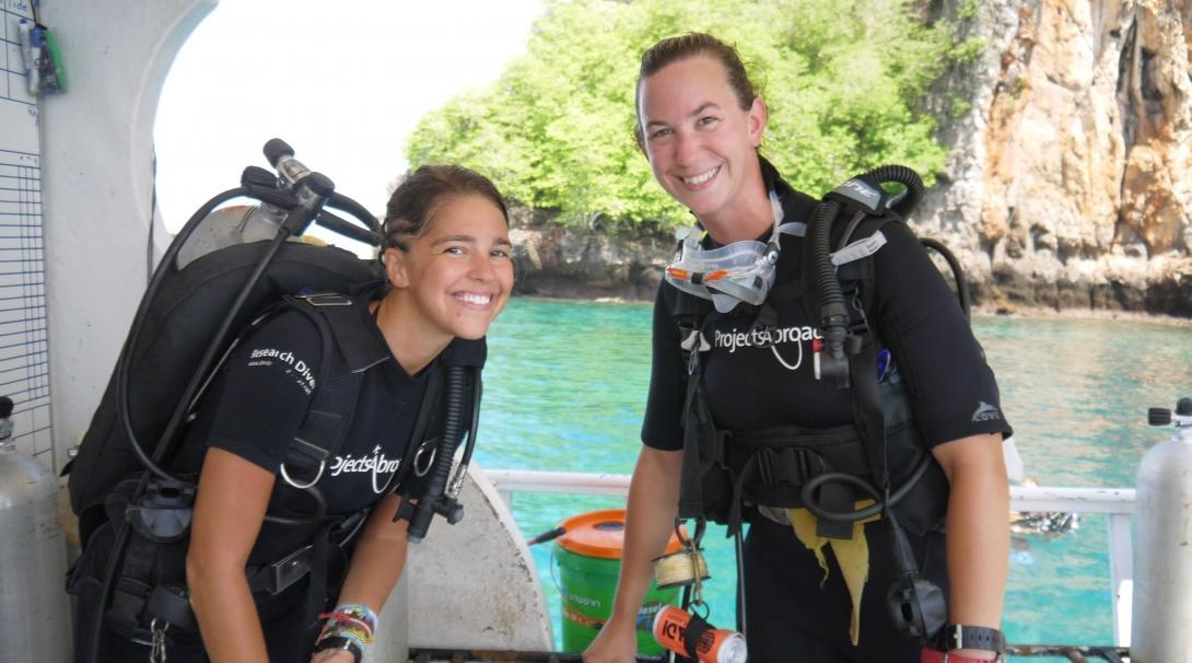 Two volunteers prepare to dive at our Conservation Project in Thailand during their Global Gap Year abroad.